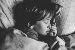 Boy sleeping in his bed